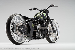 """""""Slickster"""", a black and green flames custom built from a 1974 Sportster by Adam Karns of Karns Kustoms in Delmar, MD. Photographed by Michael Lichter during the Easyriders Bike Show in Columbus, OH on February 20, 2016. ©2016 Michael Lichter."""