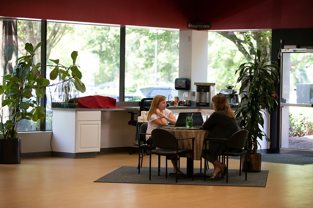 Opus Agency is a winner in The Oregonian/OregonLive's 2018 Top Workplaces competition. Autumn Brown (left), Senior Manager, Customer Success talks with Laura Burkhart, Director, Event Management, in the brand events and marketing agency's Beaverton location at 9000 S.W. Nimbus Avenue. Photo by Randy L. Rasmussen