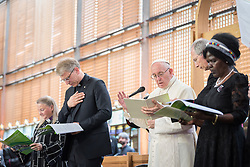 """21 June 2018, Geneva, Switzerland: On 21 June 2018, the World Council of Churches receives a visit from Pope Francis of the Roman Catholic Church. Held under the theme of """"Ecumenical Pilgrimage - Walking, Praying and Working Together"""", the landmark visit is a centrepiece of the ecumenical commemoration of the WCC's 70th anniversary. The visit is only the third by a pope, and the first time that such an occasion was dedicated to visiting the WCC. Here, an ecumenical prayer service with religious leaders from all over the world. Here, Pope Francis gives the blessing."""
