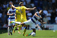 Jordan Cousins of QPR is pushed by Stuart Dallas of Leeds United. Skybet EFL championship match, Queens Park Rangers v Leeds United at Loftus Road Stadium in London on Sunday 7th August 2016.<br /> pic by John Patrick Fletcher, Andrew Orchard sports photography.