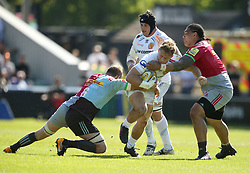 Exeter Chiefs' Sam Hill is tackled by Harlequins' Mat Luamanu (right) and Chris Robshaw during the Aviva Premiership match at Twickenham Stoop, London.