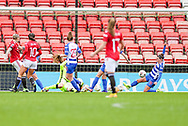 Reading defender Deanna Cooper (14) makes a goalie clearance during the FA Women's Super League match between Manchester United Women and Reading LFC at Leigh Sports Village, Leigh, United Kingdom on 7 February 2021.