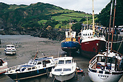 Boats in harbour at low tide, Ilfracombe, north Devon, England, UK 1970s - yacht Kiboko registered Yarmouth