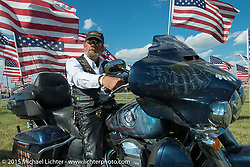 Vietnam Veteran Don Ackerman of SD at the Field of Flags memorial at the Buffalo Chip Campground during the 75th Annual Sturgis Black Hills Motorcycle Rally.  SD, USA.  August 6, 2015.  Photography ©2015 Michael Lichter.