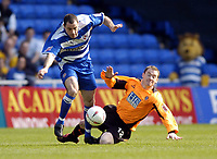 Picture: Henry Browne.<br /> Date: 02/04/2005.<br /> Reading v Sheffield United Coca-Cola Championship.<br /> Andy Hughes of Reading jumps over Alan Quinn of United.
