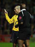 Photo: Ed Godden.<br /> Portsmouth v Arsenal. The Barclays Premiership. 12/04/2006. Freddie Ljunberg shows the Pompey fans a V sign as he is booked.