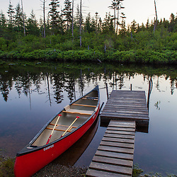 """A canoe and boat dock on the Cold Stream """"deadwater"""" above Upper Cold Stream Falls in Maine's Northern Forest. Johnson Mountain Township."""