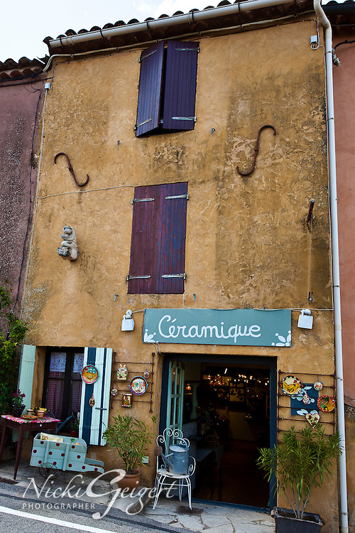 Quaint shop in village with colorful walls and windows, France. Exotic places fine art photography prints. Stock images