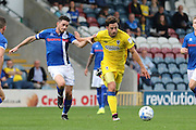 AFC Wimbledon midfielder Chris Whelpdale (11) and Rochdale FC midfielder Matthew Lund (8) during the EFL Sky Bet League 1 match between Rochdale and AFC Wimbledon at Spotland, Rochdale, England on 27 August 2016. Photo by Stuart Butcher.