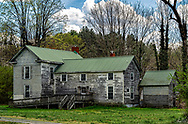 An old homestead in Bakersville's North Carolina on a sunny day with great clouds