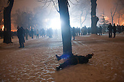 New Year's Eve (December 31) in Belgrade, Serbia. Parliament square and Pionirski Park. A drunk Serbian Soldier (or someone dressed in uniform) struggling to stay upright during New Year's Eve celebrations.