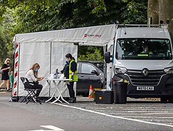 Licensed to London News Pictures. 15/07/2021. London, UK. A pop up Covid-19 Test Centre in Hyde Park today as 520,000 alerts have been sent out by the NHS Test and Trace app with Communities Secretary Robert Jenrick asking Brits to continue to use the app. Yesterday Mayor of London Sadiq Khan called on Londoners to keep using masks on public transport after restrictions are lifted this Monday 19 July 2021. Photo credit: Alex Lentati/LNP