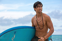 Asian American surfer at the beach in Florida
