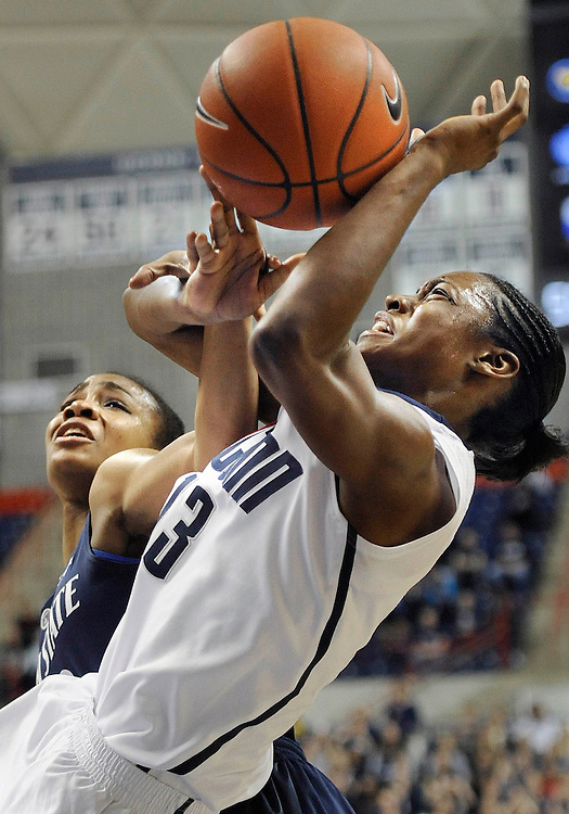 Connecticut's Brianna Banks, right, is fouled by Penn State's Ariel Edwards during the second half of an NCAA college basketball game in Storrs, Conn., Thursday, Dec. 6, 2012.  Connecticut won 67-52. (AP Photo/Jessica Hill)