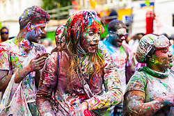The Notting Hill carnival kicks off in the early morning on Ladbroke Grove in West London with J'ouvert, a large street party celebrated by many Caribbean cultures in places where West Indian people have migrated. Paint and paint powder is thrown with many wearing protective overalls to keep their clothes clean. London, August 26 2018.