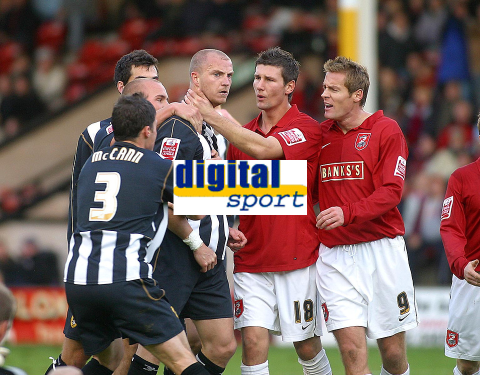 Photo: Dave Linney.<br />Walsall v Notts County. Coca Cola League 2. 25/11/2006.<br />Tempers flare between Alan White(C) and Tommy Wright<br />after a reckless challenge by the Saddlers keeper.