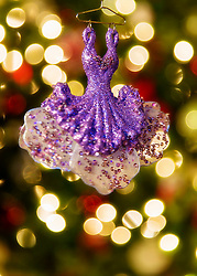 A sparkly purple dress ornament hanging on our tree - a favorite of my wife's