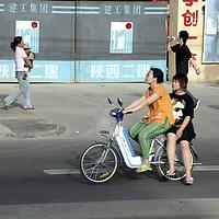 Asia, China, Shaanxi, Xian. Moped transportation in Xian, China.