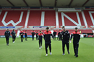 The Woking players get a feel for the pitch during the The FA Cup 2nd round match between Swindon Town and Woking at the County Ground, Swindon, England on 2 December 2018.