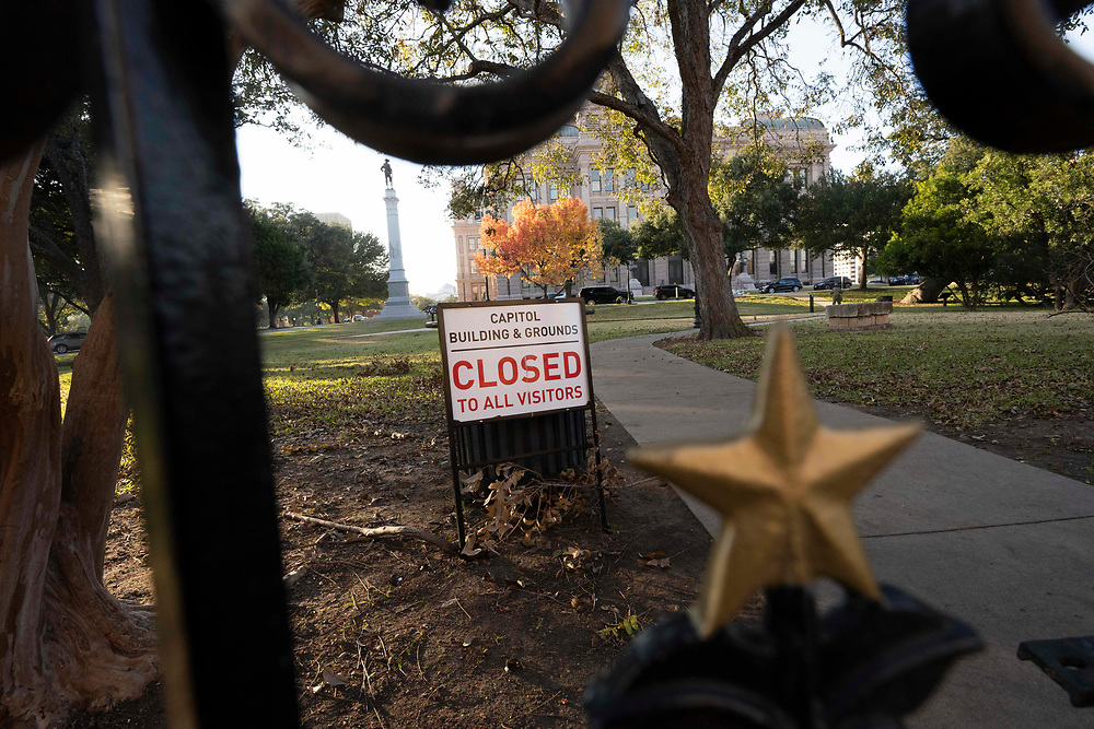 Chains surround the Texas Capitol gates in Austin the evening before Texas Governor Greg Abbott ordered the grounds reopened to the public after the Elecoral College vote on Monday. The Capitol has been closed for months following unrest and vandalism surrounding the murder of George Floyd in May, 2020.