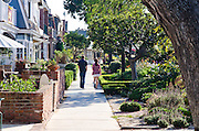 Couple Walking Through Newport Beach Neighborhood