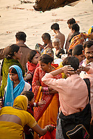 Pilgrims gather around a young bride on the ghats during the festival of Kartik Poornima in Varanasi, Uttar Pradesh, India