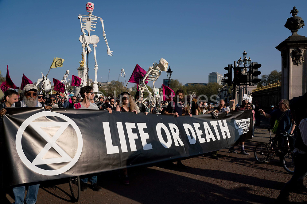 Climate Change protesters going past Buckingham Palace, during a march from Parliament Square to Marble Arch after being forced to leave Parliament Square by Police. Several roads were blocked across four sites in central London, by the Extinction Rebellion climate change protests, April 2019.