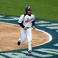 22 March 2009: #9 Michihiro Ogasawara of Japan gets back to the dugout after scoring during the 2009 World Baseball Classic semifinal game at Dodger Stadium in Los Angeles, California, USA. Japan wins 9-4 over Team USA.