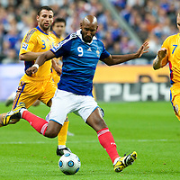 05 September 2009: French forward Nicolas Anelka vies with Romanian defender Tiberiu Ghioane during the World Cup 2010 qualifying football match France vs. Romania (1-1), on September 5, 2009 at the Stade de France stadium in Saint-Denis, near Paris, France.