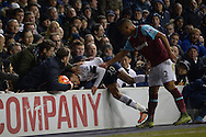 Dele Alli of Tottenham Hotspur falls into the fans after being pushed by Winston Reid of West Ham United. Barclays Premier league match, Tottenham Hotspur v West Ham Utd at White Hart Lane in London on Sunday 22nd November 2015.<br /> pic by John Patrick Fletcher, Andrew Orchard sports photography.