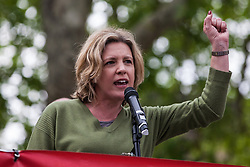 London, UK. 1st May, 2019. Laura Parker of Momentum addresses climate protesters at a Declare A Climate Emergency Now demonstration in Parliament Square organised to coincide with a motion in the House of Commons to declare an environment and climate emergency tabled by Leader of the Opposition Jeremy Corbyn. The motion, which does not legally compel the Government to act, was passed without a vote.