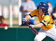 OFallon batter Haidyn McGill bunts. OFallon defeated Edwardsville in a baseball sectional playoff game at Edwardsville High School in Edwardsville, IL on Wednesday June 9, 2021. <br /> Tim Vizer/Special to STLhighschoolsports.com.