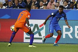 France's Thomas Lemar battling Netherlands's Quincy Promes during the World Cup 2018 Group A qualifications soccer match, France vs Netherlands at Stade de France in Saint-Denis, suburb of Paris, France on August 31st, 2017 France won 4-0. Photo by Henri Szwarc/ABACAPRESS.COM