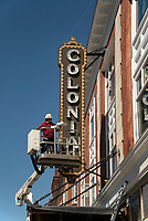 Hanging the Blade and Marquee at the Colonial Theater in downtown Laconia.   ©2021 Karen Bobotas Photographer