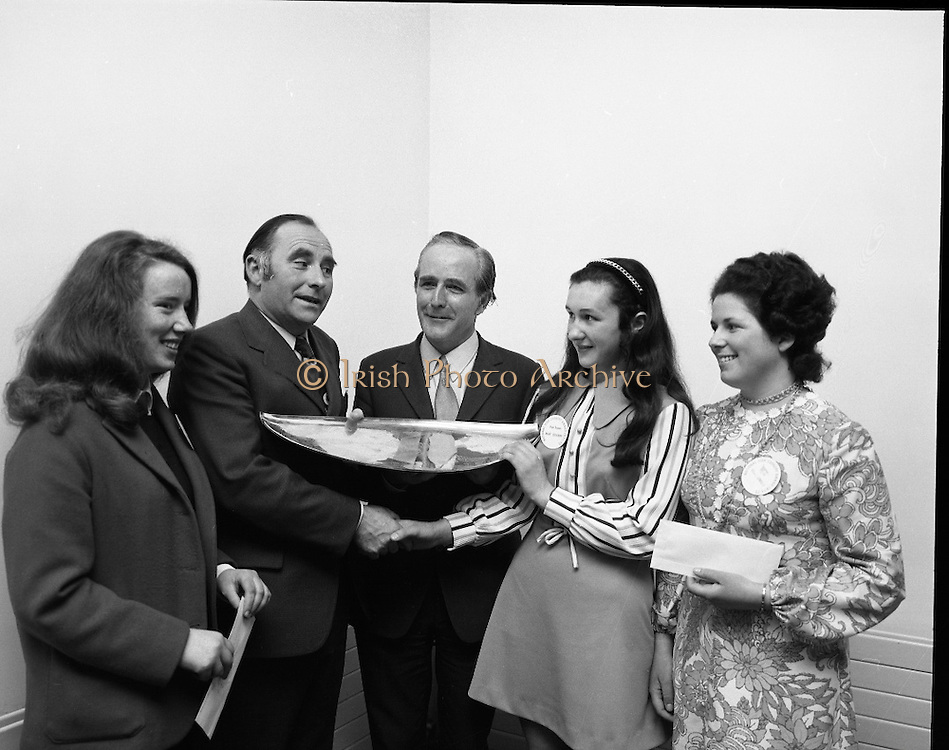 """B.I.M.National Seafood Cook..1972..05.05.1972..05.05.1972..5th May 1972..The final of the """"National Seafood Cook 1972"""" was held in the Great Southern Hotel,Killarney,Co Kerry.The winner was Miss Mary Coleman (14 years)from the Vocational School, Claremorris,Co Mayo.The title of the winning dish was """"Amber Ring. She was chosen from 18 regional finalists...Picture of Maria Geoghegan ((3rd),Mr Jackie Fahy TD,(left),Parliamentary Secretary to the Minister for Agriculture, presenting the Perpetual Challenge Trophy and a cheque fur £150 to the winner Ms Mary Coleman,Claremorris,Co Mayo, Celine O'Reilly(2nd) and Mr T F Geoghegan,Market Development manager,Bord Iascaigh Mhara (B.I.M.)Centre."""