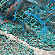 Fishing nets piled up on a pier for commercial fishing boats, Gloucester, MA
