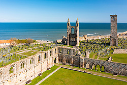 Aerial view from drone of St Andrews town and St Andrews Cathedral ruins, Fife, Scotland, UK and