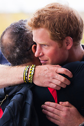 Queen Elizabeth Olympic Park, London. September 13th 2014. Prince Harry hugs a competitor as wounded servicemen and women from 13 different countries compete for sporting glory during the cycling competition at the Invictus Games.