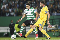 October 31, 2017 - Lisbon, Portugal - Sporting's midfielder Marcos Acuna (R) vies with Juventus's defender Andrea Barzagli during the Champions League  football match between Sporting CP and Juventus FC at Jose Alvalade  Stadium in Lisbon on October 31, 2017. (Credit Image: © Carlos Costa/NurPhoto via ZUMA Press)