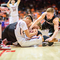 031215  Adron Gardner/Independent<br /> <br /> Gallup Bengal Matt Begay (33) ties up with Grants Pirates Trey Narramore (22), left, and Keegan Stewart (11)  for a jump ball during a 5A New Mexico state basketball tournament semifinal at The Pit in Albuquerque Thursday.  The Bengals beat the Pirates 70-36.