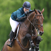 Cara Raether Carey riding Winston in action during the $35,000 Grand Prix of North Salem presented by Karina Brez Jewelry during the Old Salem Farm Spring Horse Show, North Salem, New York, USA. 15th May 2015. Photo Tim Clayton