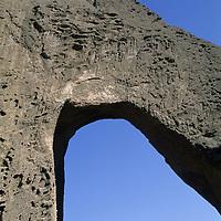 Mountaineers stand atop Shipton's Arch in the Kara Tagh Mountains near Kashgar, Xinjiang, China.