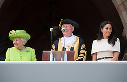 Queen Elizabeth ll and Meghan, Duchess of Sussex stand with the Lord Mayor of Chester at Chester Town Hall during a visit to Chester on June 14, 2018.  This is the Duchess's first solo engagement with The Queen