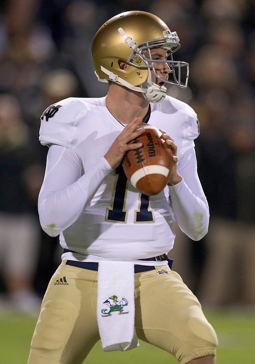 October 01, 2011:  Notre Dame quarterback Tommy Rees (#11) sets in the pocket to deliver pass during NCAA Football game action between the Notre Dame Fighting Irish and the Purdue Boilermakers at Ross-Ade Stadium in West Lafayette, Indiana.  Notre Dame defeated Purdue 38-10.