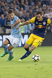 September 20, 2017 - Kansas City, Kansas, U.S - Sequence 02-02: NY Red Bulls defender Aaron Long #33 (r) gains the defense against Sporting KC forward Diego Rubio #11 (l) during the first half of the game.  Sporting KC will win the 2017 Lamar Hunt Open Cup championship with a score of 2-1 over the New York Red Bulls. (Credit Image: © Serena S.Y. Hsu via ZUMA Wire)