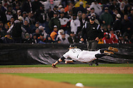 CHICAGO - OCTOBER 23:  Joe Crede of the Chicago White Sox makes a spectacular diving play during Game 2 of the 2005 World Series against the Houston Astros at US Cellular Field on October 23, 2005 in Chicago, Illinois.  The White Sox defeated the Astros 7-6.