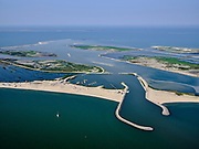 Nederland, Flevoland, Markermeer, 26-08-2019; Marker Wadden in het Markermeer. Overzicht, haven met strekdammen. Trintelzand in de achtergrond.<br /> Doel van het project van Natuurmonumenten en Rijkswaterstaat is natuurherstel, met name verbetering van de ecologie in het gebied, in het bijzonder de kwaliteit van bodem en water<br /> Naast het hoofdeiland is er inmiddels een tweede eiland in wording, de uiteindelijk Marker Wadden archipel zal uit vijf eilanden bestaan. <br /> Marker Wadden, artifial islands. The aim of the project is to restore the ecology in the area, in particular the quality of soil and water.<br /> The first phase of the construction, the main island, is finished. <br /> <br /> luchtfoto (toeslag op standard tarieven);<br /> aerial photo (additional fee required);<br /> copyright foto/photo Siebe Swart