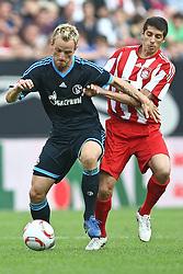 07.08.2010,  Augsburg, GER, 1.FBL, Supercup, FC Bayern Muenchen vs FC Schalke 04,  im Bild Ivan Rakitic (Schalke #10) im Kampf mit Jose Sosa (Bayern #20) , EXPA Pictures © 2010, PhotoCredit: EXPA/ nph/ . Straubmeier+++++ ATTENTION - OUT OF GER +++++ / SPORTIDA PHOTO AGENCY