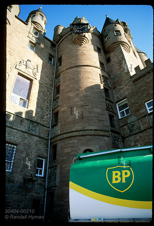 British Petroleum truck parks in front of Glamis Castle, childhood home of Queen Mother, to deliver heating oil; Glamis, Scotland.