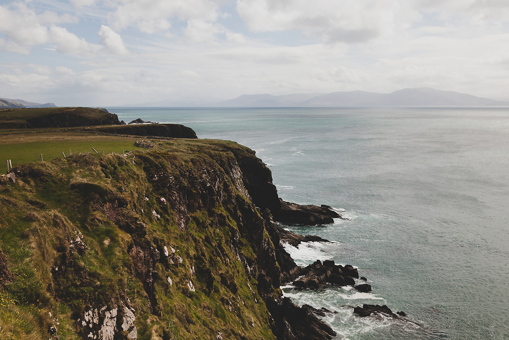 The cliffs of Dingle meeting the Atlantic Ocean on the outskirts of southwest Ireland.